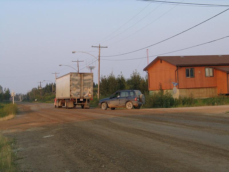 Truck on Bay Road near railway crossing in Moosonee.