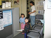 Meridian Loon and Cecilia Lee with Yuke Man in reception area at Keewaytinok Native Legal Services 2004 July 16