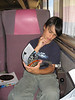 David Hunter on the train to Moosonee reading Guns & Ammo magazine 2005 August 10