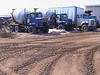Concrete trucks and other trucks at the base 2003 April 13