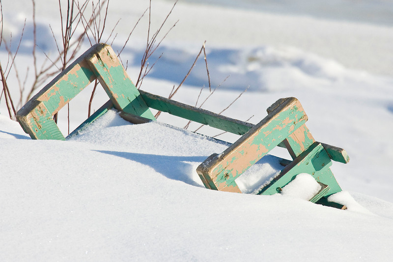 Taxi boat bench, in snow, inverted on angle