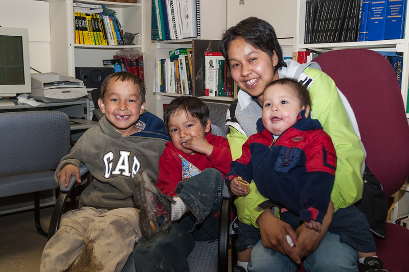 Natasha Blueboy with three of her children in the library at Keewaytinok Native Legal Services 2005 May 6