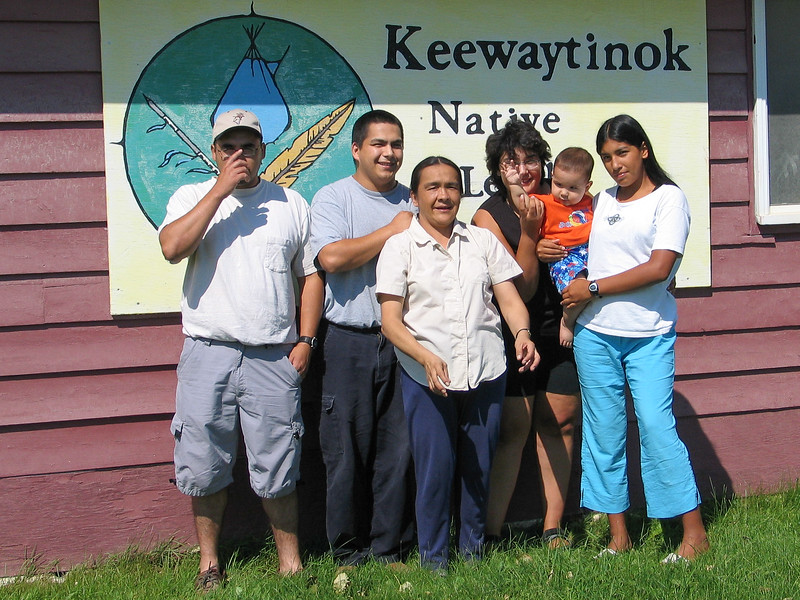 Craig and Aaron Nootchtai, Mary Blueboy, Loretta and Ashley Trudeau with baby outside Keewaytinok Native Legal Services 2003 August 26