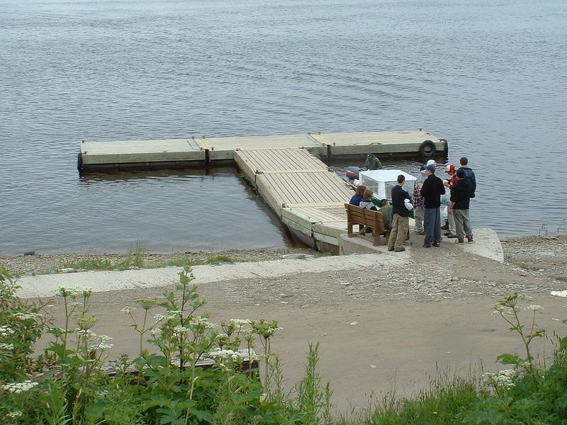 People waiting on public docks in Moosonee.