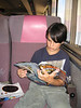 David reading on the train to Moosonee 2005 August 10 11:10 am