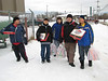 Bishop Belleau School students heading back to school with food for their Christmas party 2006 December 20th.