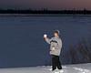 David Hunter holding a piece of snow along the river bank 2005 November 26