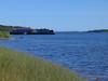 Moose River shoreline looking down river towards barge docks in Moosonee. 2003 September 8th.