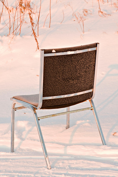 Chair outside along river bank in Moosonee just after sunrise