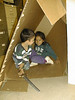David Hunter and Danis Akiwenzie playing in box in storage room at Keewaytinok Native Legal Serevices 1998 September 6.