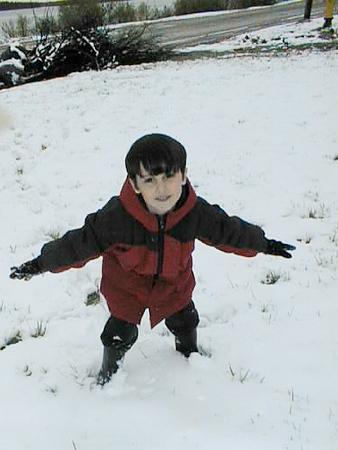 David jumping in snow May 19, 1999