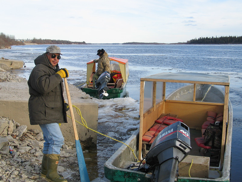 Robert Blueboy and Leo Etherington with their taxi boats at public docks site in Moosonee 2003 November 22.