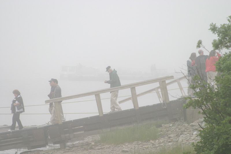 Passengers head down ramp to Two Bay dock to board the Polar Princess on a foggy morning. 2004 August 26