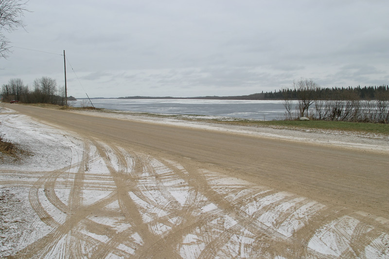 Looking across Revillon Road to the frozen over Moose River 2004 November 25.