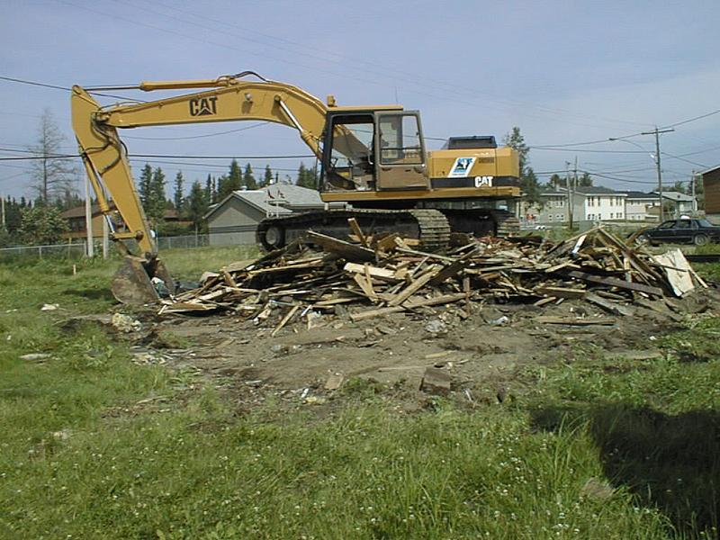 Demolition of Keewaytinok Native Legal Services staff house 2002 August 13.