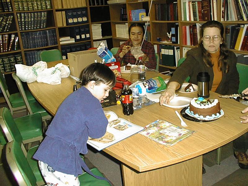 Birthday party for David at Keewaytinok 1999 January 31st. Mary Blueboy, Linda Tranter.