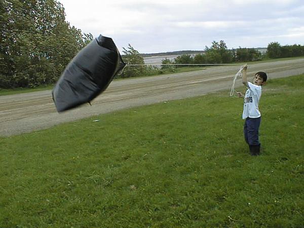 David Hunter flying garbage kite in heavy wind. 2001 June 19