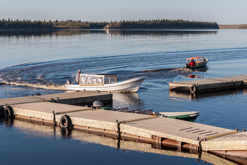 Taxi boats coming and going at public docks in Moosonee. 2005 May 25