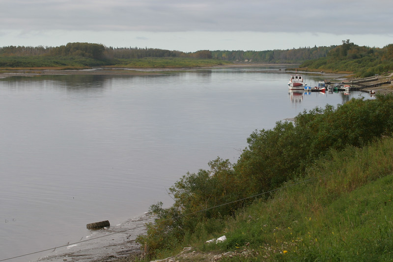 Looking up the Moose River shoreline from near barge docks 2004 September 26
