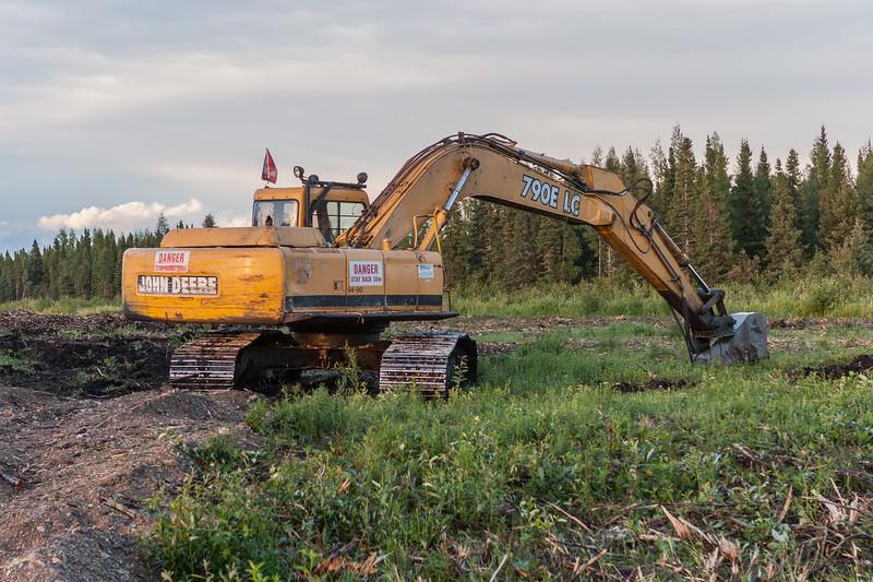 Clearing land for DeBeers Moosonee yard. John Deere 790E LC with brushing tool near Butcher Street