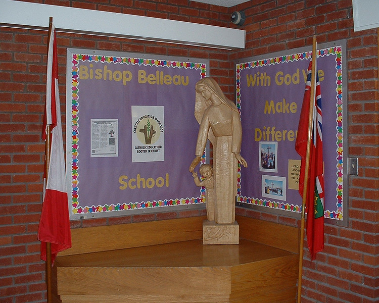 Bishop Belleau School flags and statue in front hall 2003 May 17th.