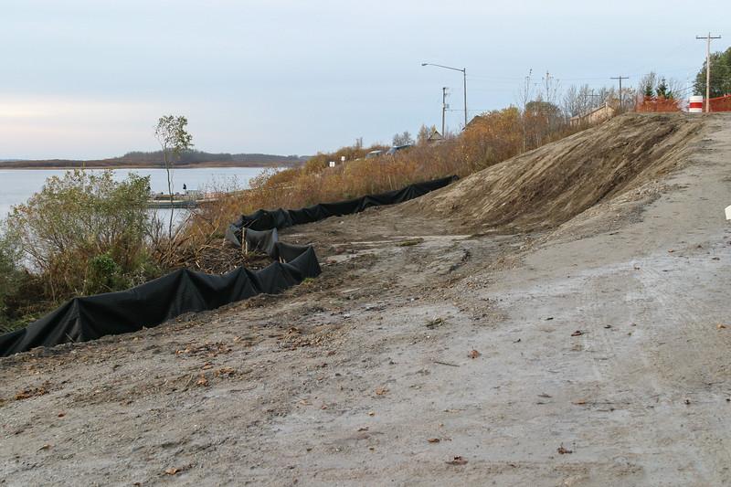 2004 October 23 shoreline rehabilitation work above Two Bay docks in Moosonee. Geotextile fabric showing.