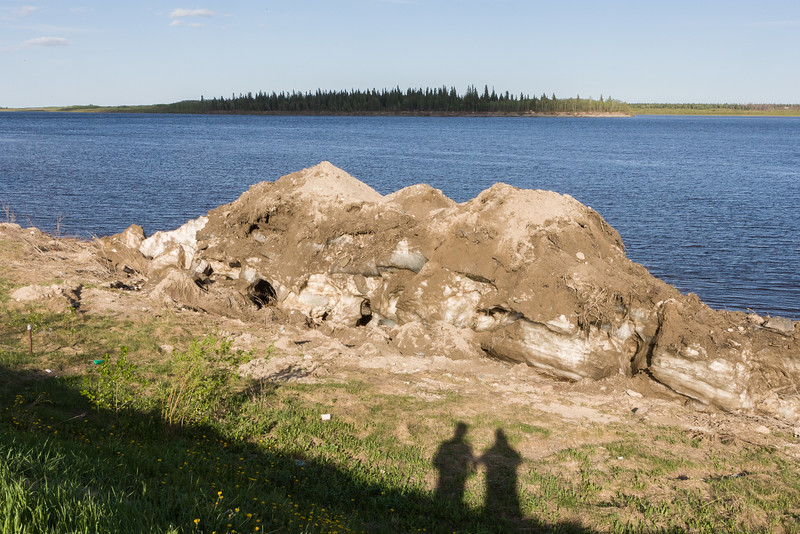 Pile of ice on the Moose River shoreline in Moosonee. Two shadows. 2006 May 31st