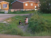 Children playing in drainage ditch in Moosonee.