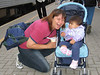 Jacqueline Linklater with baby at Moosonee train station.