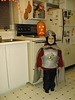 David, dressed as Red Knight, in front of pumpkin on stove in clinic apartment kitchen in Moosonee 1998 October 31.