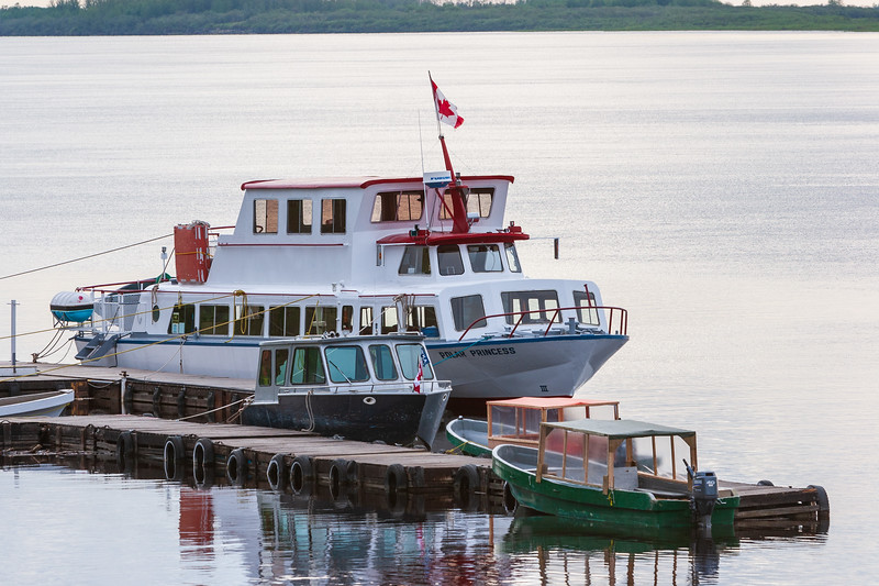 Tour boat Polar Princess with other boats at Two Bay docks in Moosonee 2005 May 29.