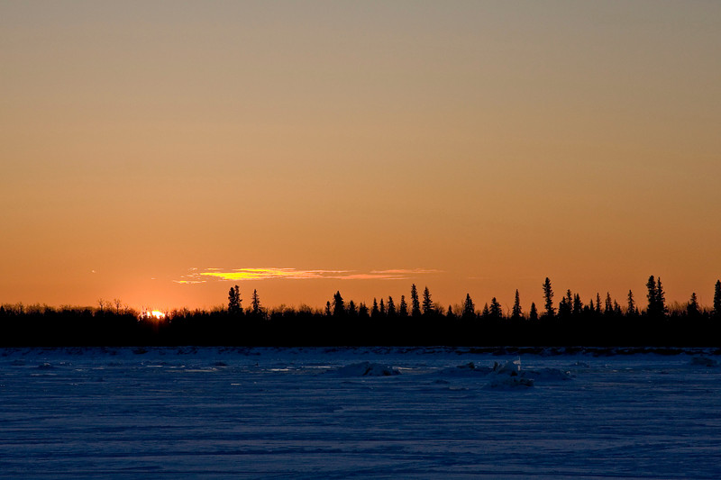 Sunrise over Charles Island in the Moose River across from Moosonee, Ontario 2007 December 12th.