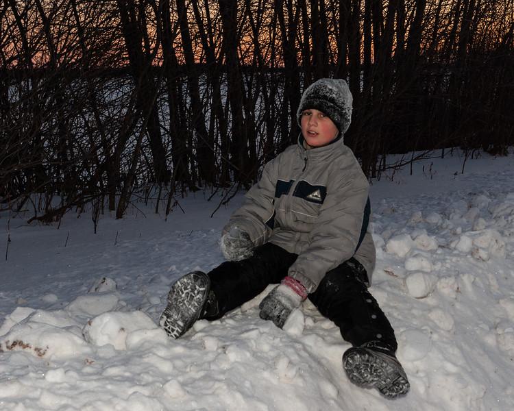 David Hunter sitting on a snow bank along Revillon Road 2005 November 26