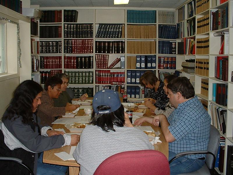 Meeting in library at Keewaytinok Native Legal Services 2004 October 20 including Ken Wesley, John Paul Nakochee, Laura Uiselt, Maude Tyrer, Dana Milne, Donna Ashamock, Paul Lantz