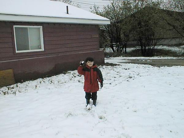 David holding small snowball May 19, 1999