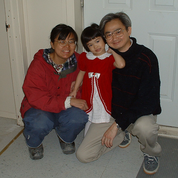 Cecilia Lee in front of door at Keewaytinok Native Legal Services with her parents Yuke Man and Fintan Lee 2003 May 6
