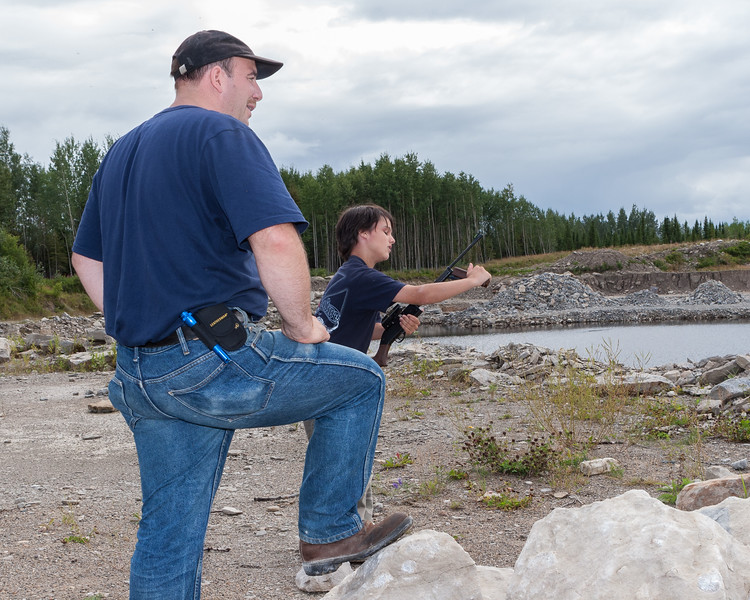 Craig Jennings helping David Hunter learn to use his pellet rifle at the quarry 2005 August 13