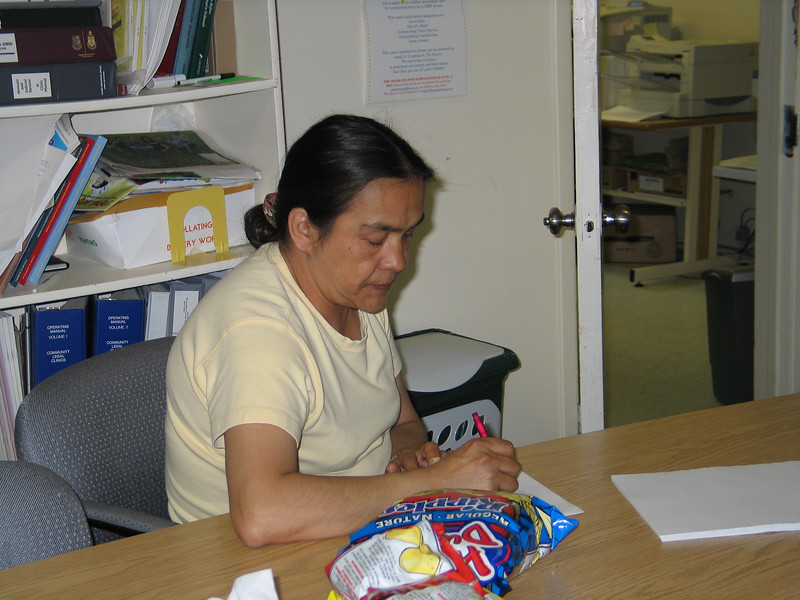 Mary Nootchtai writing in library 2004 July 14