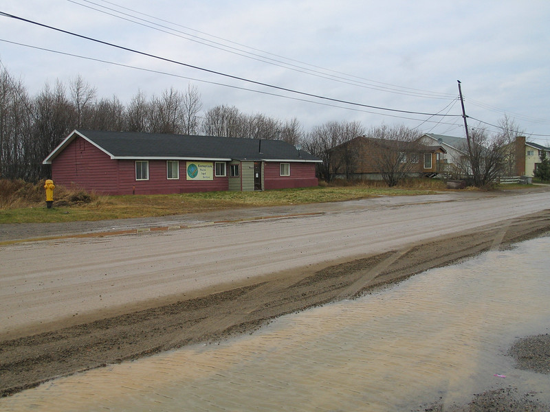 Lots of water on Revillon Road in front of Keewaytinok Native Legal Services 2003 November 19th.