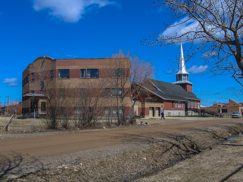 Christ the King Roman Catholic Cathedral and its rectory in Moosonee.