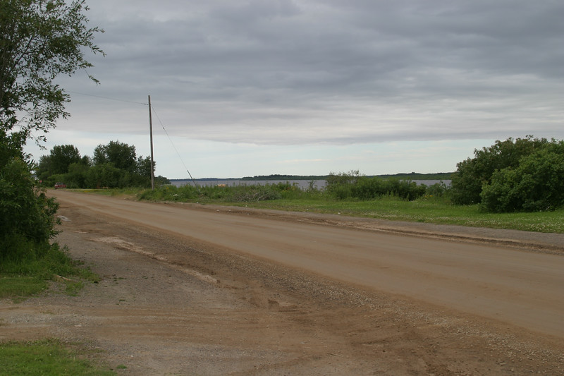 Looking down Revillon Road before river bank cleared for shoreline stabilization. 2004 August 13