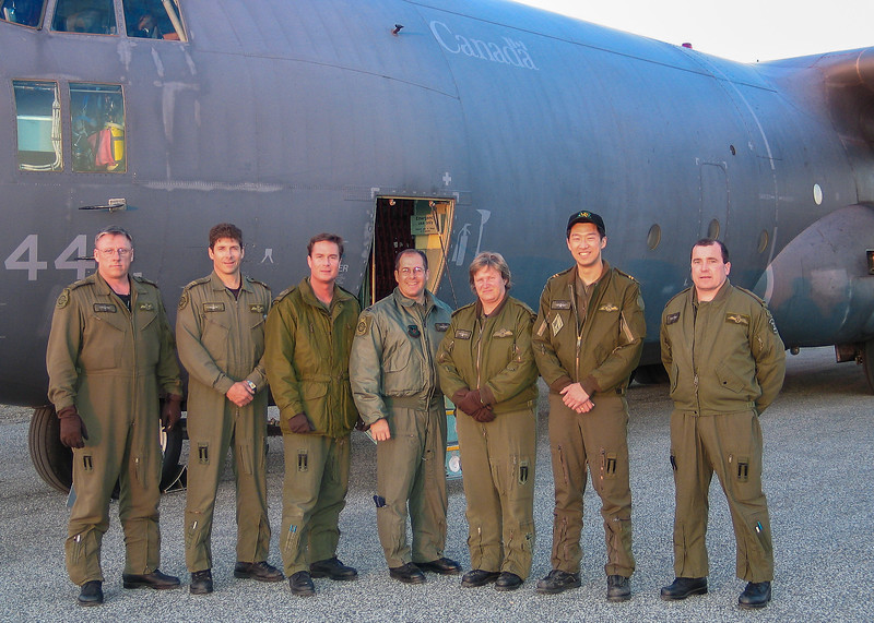 C-130 Hercules with crew at Moosonee Airport. Used in Attawapiskat evacuation. 2004 May 21