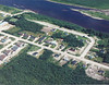 1988 aerial of Ferguson Road in centre, then Revillon Road South (now Veterans) with Moose River at top of image.