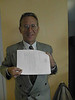 Brad Sloan, Timmins lawyer, in Moosonee holding letter. 1998 May 11