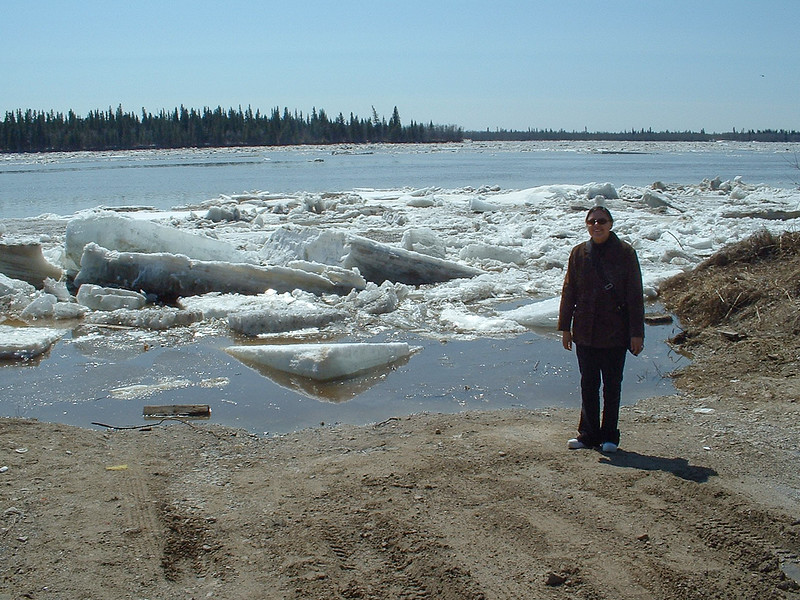Loretta Loon in front of the Moose River's breaking ice. Butler Island in the background 2003 May 6