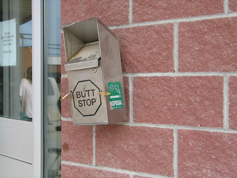 Locked butt stop receptable at Northern Store in Moosonee 2003 August 19