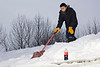 Anthony Isaac shovelling snow off Keewaytinok Native Legal Services roof New Year's Eve 2007