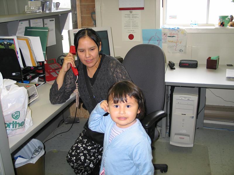 Loretta with Meridian at reception desk Keewaytinok Native Legal Services
