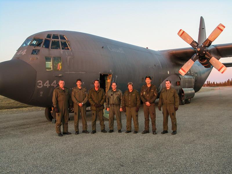 C-130 Hercules at Moosonee Airport with crew. Used in Attawapiskat evacuation. 2004 May 21