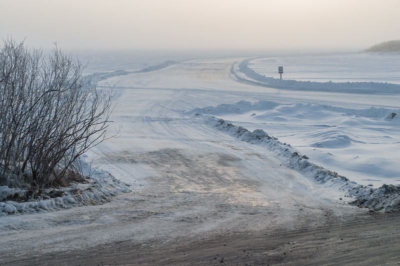 2005 March 14 on a foggy morning start of the road across the Moose River at McCauley's Hill in Moosonee
